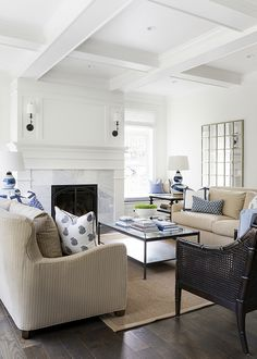 blue and white accent pillows on neutral beige furniture New Construction Grey Shingle Home