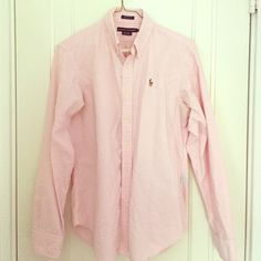 Ralph Lauren Light Pink Classic Fit Button Down Lightly worn Ralph Lauren light pink classic fit button down in striped light pink. Loved this shirt for a long time. Looks great oversized or fit to match. Classic and cute. A little hole in back but barely noticeable and gives a rustic vibe :) Ralph Lauren Tops Button Down Shirts