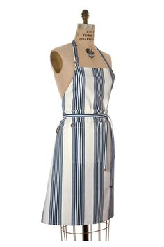 """Our """"Signature"""" Bib Apron is roomy enough for both men & women and has an adjustable neck. The Hudson style is made of 100% blue & white nautical stripe printed cotton canvas. The double-front pocket is detailed with antique brass metal """"sail cloth"""" grommets. All aprons have our signature birdkage™ embossed metal d-ring and come [...]"""