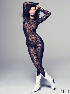 Bella goes sheer in a lace bodysuit from Fleur Du Mal.