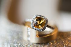 citrine engagement ring, photo by Photography Stylistas http://ruffledblog.com/elegant-parisian-styled-wedding #rings #engagementring