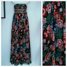 📣SALE🚩🌹HP🌹Gypsey Maxi Dress🌟🌟🌟🌟🌟5 stars PRICE FIRM  Gorgeous gypsy maxi dress by Pearl. Stunning floral print, gold bands at bust and charm details.  Body and lining 100%polyester Sizes 0,2 and 10 Pearl Dresses Maxi
