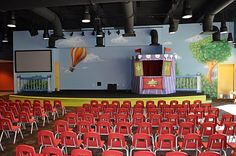 Worlds of Wow - The stage theme for the Flying Ferris Wheel room for 1st and 2nd grade students at Gateway Church in Southlake, TX, includes a stage mural and a fun themed puppet stage.