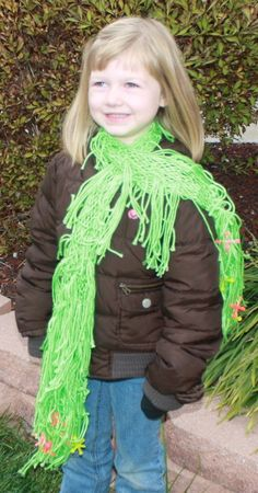 Super-Soft lime sherbert driseling across your favorite young girls' shoulders. Perfect compliment to all the hottest color creations in fashion. For a bit of whimsy, jacks have been mixed in to the fringe. Remembrance of a simpler time!