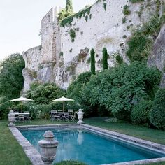 In the medieval hill town of Ménerbes, France, a fortified château dating back to the 11th century was sensitively renovated at the hands of an American couple, with the help of French designer Michel Biehn. The swimming pool—a copy of an 18th-century stone bassin—was set beside the medieval ramparts of the village, 180 feet below the level of the house. (July 2005) Photo: Marina Faust