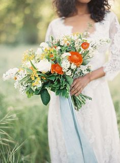 Colorful wedding bouquet in yellow, orange and white.