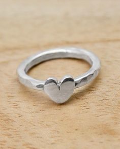 A pretty handmade silver ring featuring a highly polished heart on a hammered shank. The ring is also available in a smooth surface finish. #heart #ring #silver #jewellery #cornwall #uk #gb #westcountry #devon #england #silversmith #pretty #jeweller #jewellers #handmadejewellery