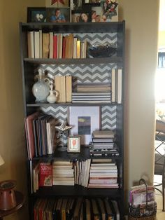 Using a fun patterned contact paper on the inside of the book shelf backing to add a textural element to the room.