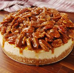 Pecan Pie Cheesecake has a crunchy pecan crust, a velvety brown sugar cheesecake layer and is topped with gooey caramel and toasted pecans. This Pecan Cheesecake is the perfect Holiday dessert and so easy to make without a water bath! Pumpkin Recipes, Pie Recipes, Sweet Recipes, Baking Recipes, Dessert Recipes, Dessert Recipe Video, Food52 Recipes, Mac Cheese Recipes, Pecan Recipes