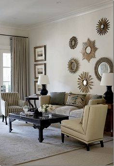 Decor By Suzanne Kasler For An Atlanta House The Row Of Prints Balances Mirror Arrangement Linda Purcell Wall Behind Sofa