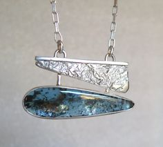 A modern pendant featuring kyanite and textured sterling.