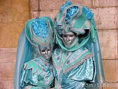 Venice Carnival: Couple in turquoise costumes by Andreas Steinbach, via Dreamstime
