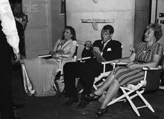 Original caption: Hollywood producer and star Gary Cooper photographed in between scenes in a rare candid shot. At his right is Barbara Stanwyck, with whom he appeared in Ball of Fire, 1941.