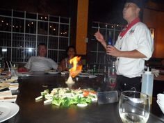 Kobe's Japanese restaurant Orlando/Florida.  A fabulous show performed by your own Chef, Amazing!!!!  http://www.kobesteakhouse.com/