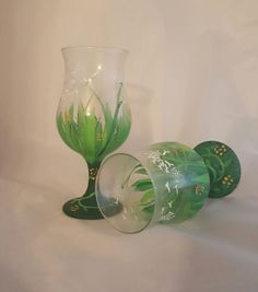 This set of hand painted glasses features a pretty dandelion pattern heralding in spring!