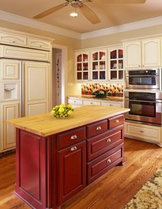 nice red cabinets - deep color, red accents with cream/white cabinets.  Liking it.