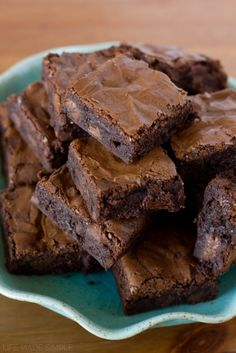 Fudgy and thick chocolate brownies with chocolate chunks melted inside.