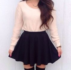 Soft pink long sleeve shirt, black skater skirt,black knee high socks