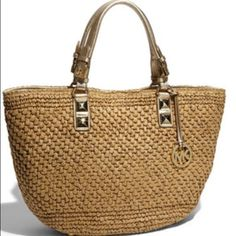 Michael Kors straw bag Michael Kors Straw bag with gold accents. This is the perfect bag for your vacation mindset. Fully lined interior with plenty of pockets, 4 slip & one zippered. Gently used. Beautiful!🌴 No trades.🌞😎 MICHAEL Michael Kors Bags Totes