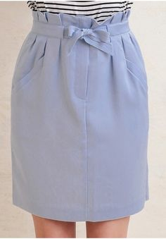 This versatile blue skirt is great for a business lunch or an afternoon date.