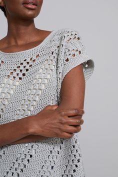 Crocheted Diagonal Eyelet Top-Free Pattern - Nana's Favorites This easy to crochet Eyelet Top is light and airy and perfect for any summer wardrobe. The FREE pattern instructions also includes plus sizes! Mode Crochet, Crochet Lion, Crochet Woman, Knit Crochet, Crochet Vests, Crochet Hook Sizes, Crochet Stitches, Crochet Edgings, Crochet Motif