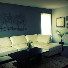 ~Clean space with a nice focal point-the metal tree wall art.~ Living room