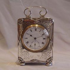 Antique Art Nouveau silver cased carriage clock. - Gavin Douglas Antiques