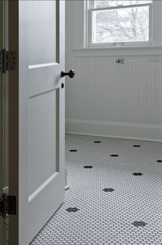 suzie cameo homes vintage bathroom with white vintage hex tiles with black vintage hex inset