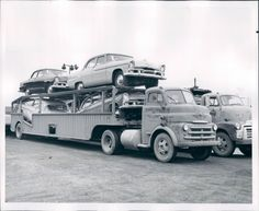Four old cars on an old truck.  www.travisbarlow.com Towing Insurance and Auto Transporter Insurance for over 30 years