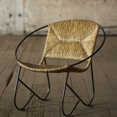 This hand crafted beauty has lazy days of summer written all over it. Hula hoop round metal forms the bend of the back, seat and arms; legs are shaped like dual wings. The seat and backrest are covere...