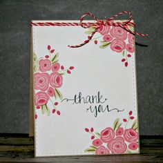 Flowers from the Thanks a bunch stamp set have been beautifully colored on this handmade thank you card. Love the added simplicity of a faux stitched border and simple peppermint cord bow.