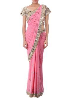 Peach saree embellished in kundan and mirror only on Kalki - Kalkifashion.com