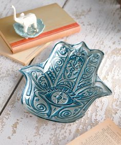 Representing protection, this Hamsa shaped glass platter is a quintessentially Eastern and elegant accent. Use it to place jewelry in the boudoir or a pretty place to plop keys next to the front door.