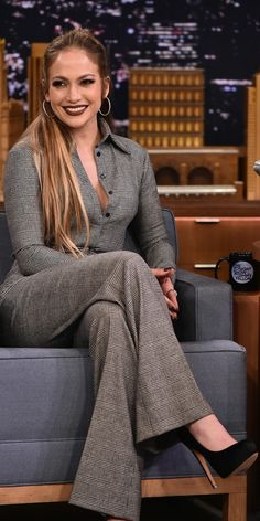 Who made  Jennifer Lopez's plaid button down shirt and pants?