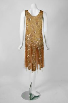 """1920's antique french  metallic gold couture silk-net dance dress and matching evening coat from """"Fleurette"""".  This ensemble is embellished all over with sequins and glass-beads, whose faceted cut creates a dazzling sparkle. Back"""