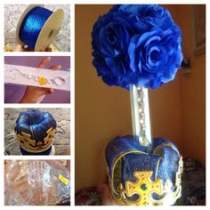 Another view of the centerpiece for the Royal Prince baby shower  $5 blue flower (bought assembled)  $1.25 for tube $1 crown @.30-.50 cents worth of thick Royal blue&gold ribbon  $1 dangling jewelry  $1.50 base for centerpiece