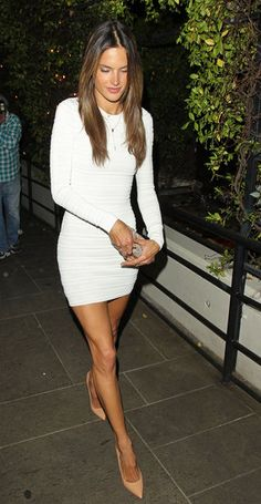 Alessandra Ambrosio in white long-sleeved dress and nude pointed-toe heels