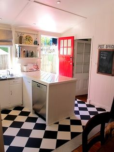 diagonal tile floor would make kitchen seem wider, but maybe less contrast than black & white.... grey/brown?