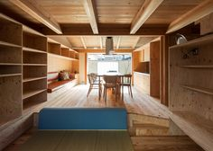 A wooden structure and hand-built joinery are left exposed throughout the interior of this compact house in Japan