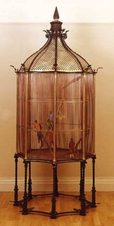 English Victorian Bronze And Copper Octagonal Shaped Monumental Bird Cage With Gilt Pierced Dome And Finial Top Raised On 8 Swirl Iron Legs