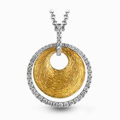 This striking contemporary pendant features an eye-catching geometric design in white and yellow gold accented with .43 ctw round cut white diamonds.