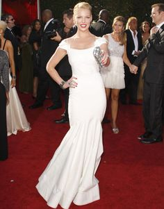 Heigl wears white Zac Posen and takes home an Emmy for her work on Grey's Anatomy.  Read more: Katherine Heigl Images - Red Carpet Photos of Katherine Heigl - Harper's BAZAAR  Visit us at HarpersBAZAAR.com