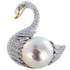Pearl and diamonds swan pin.