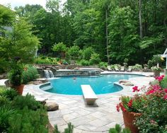 OMG how spectacular ....lush landscaping and a gorgeous pool with waterfall.... breathtaking !