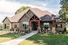 This 4 bed Southern Craftsman house plan has a mixed-material exterior blending brick, stone, and shake siding giving it great curb appeal. Double-entry doors lead you into the foyer with 10 House Plans One Story, Best House Plans, Dream House Plans, Story House, House Floor Plans, Stone House Plans, Floor Plan 4 Bedroom, Bedroom House Plans, Basement House Plans
