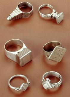 Africa | Rings from the Tuareg people of Algeria (top two) and from Niger (bottom 4) | Silver #africa rings design jewelry silver