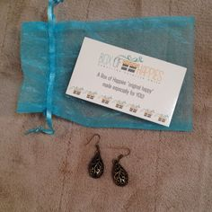 Box of happies earrings NWOT Bronze color earrings. Received in a subscription and don't wear earrings. Make an offer or bundle to save! Jewelry Earrings