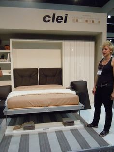 Clei offered a modern take on the Murphy bed called Compact Living Solutions. It's a modular unit of wall bed with sofa, to which you can add storage and shelving units.    The styling is young and sleek. The wall bed unit was drawing a crowd on the floor both in the closed and open positions. Once you customize your unit, it is delivered to your door flat packed to be installed by a contractor. It's perfect for small urban dwellings, studios and guestrooms.
