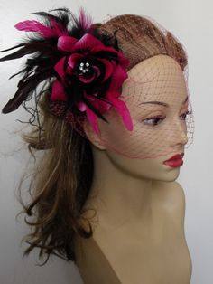 Hot pink and Black Fuchsia Headpiece and Birdcage veil.... I like this but with pink and white!
