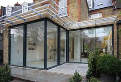 Rear residential extension with Minimal Windows sliding doors opening on the corner by IQ Glass